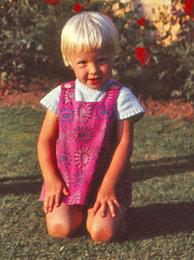 Inger in garden aged 4-5